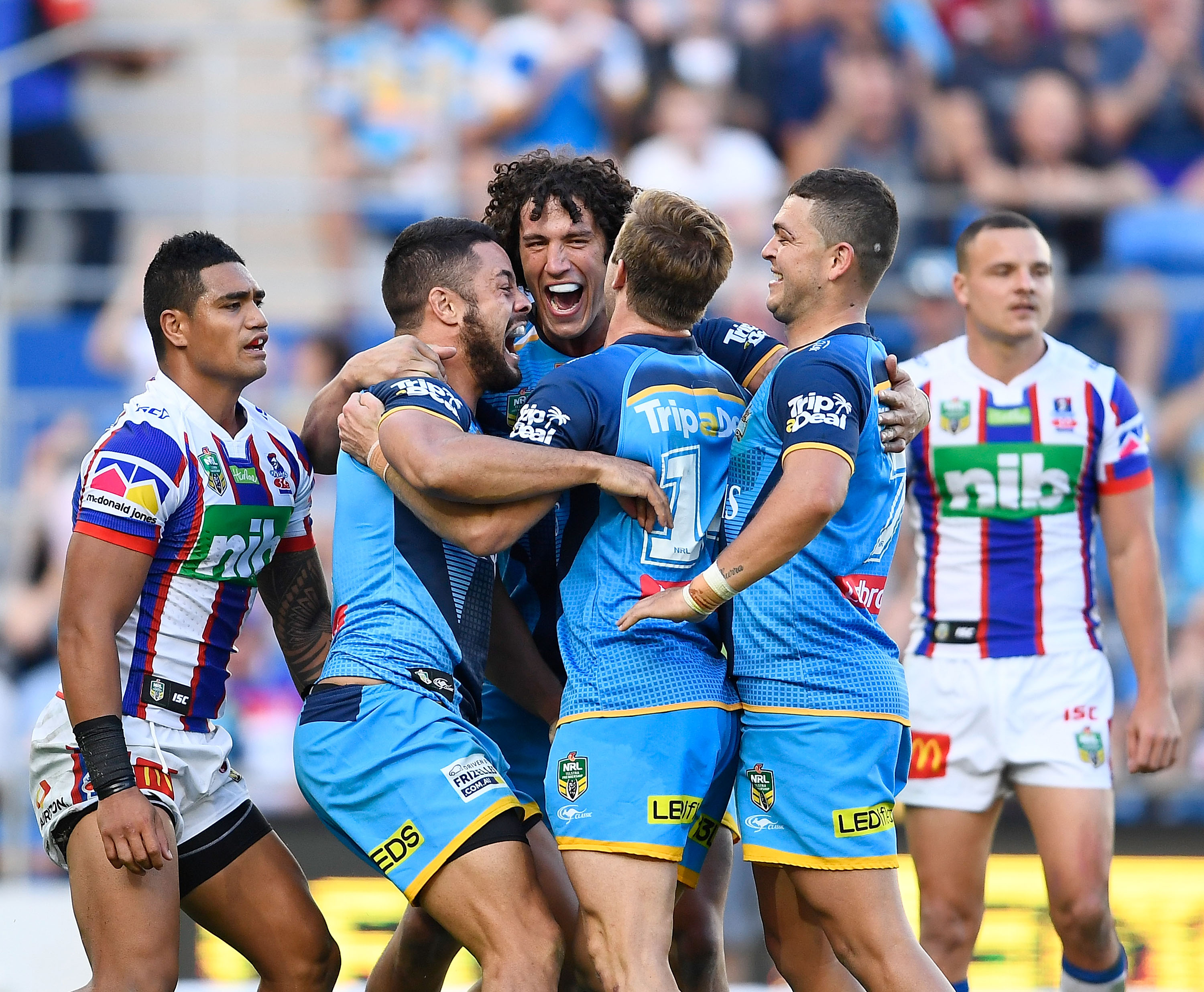 Titans players celebrate against the Knights. Photo / Getty Images