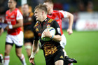 Damian McKenzie of the Chiefs runs away to score against the Sunwolves. Photo / Getty Images