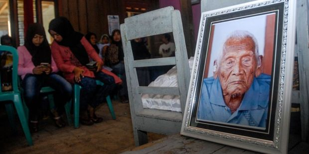 Families attend the funeral ceremony of Mbah Gotho, an Indonesian man who claimed to be the oldest human in world's history. Photo / Solo Imaji / Barcroft Images / Barcroft Media via Getty Images