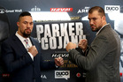 Joseph Parker and Razvan Cojanu size each other up ahead of their WBO heavyweight title fight in Auckland tonight. Photo / Getty Images.