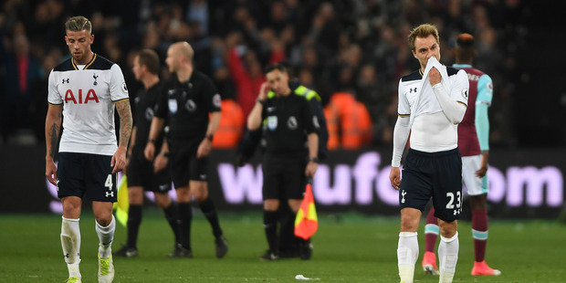 Dejected Tottenham stars Toby Alderweireld (left) and Christian Eriksen walk off the London Stadium pitch following their 1-0 loss to West Ham this morning (NZT). Photo / Getty Images.