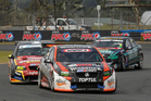 Andy Booth in his Holden ahead of Scott McLaughlin during a SuperTourers race. Photo / Photosport