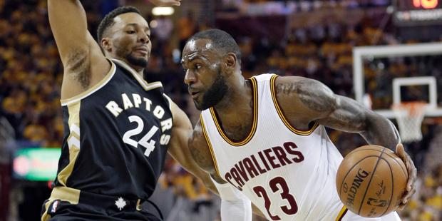 Cleveland Cavaliers' LeBron James drives against Toronto Raptors' Norman Powell. Photo / AP