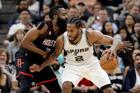 San Antonio Spurs forward Kawhi Leonard tries to post up Houston Rockets guard James Harden. Photo / AP