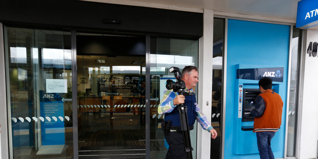 Loading The scene of the armed hold up at ANZ bank in Glenfield. Photo / Dean Purcell
