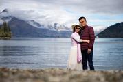 Tourists pose for photo on the Lake Wakatipu shore. Photo / Mike Scott