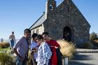 Tourists at the Church of the Good Shepherd at Lake Tekapo. Photo / Mike Scott