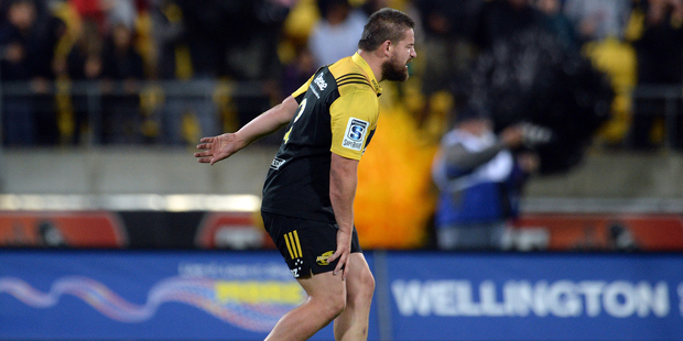 Hurricanes captain Dane Coles walks off the field with a calf injury during the Super Rugby match between his side and the Highlanders at Westpac Stadium in March. Photo / Photosport