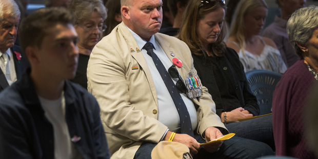 Rob Clark wore medals proclaiming service across the world.