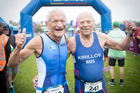 2017 World Masters games competitors 84 year olds New Zealander Garth Barfoot and his Russian billet Boris Kirillov celebrate finishing the sprint triathlon in St Heliers. Photo / Greg Bowker.
