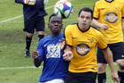 Massey's Haacihyo Haanyika jostles with City's Adrian Ngaau during City's big win at Wembley Park on Saturday.