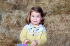 Princess Charlotte is wearing a cardigan from John Lewis.