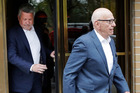 In this April 24, 2017 photo, Fox News co-president Bill Shine, left, leaves a New York restaurant with Rupert Murdoch, the executive chairman of 21st Century Fox. Photo / AP