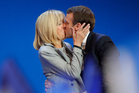 Emmanuel Macron kisses his wife Brigitte before addressing his supporters in Paris. Photo / AP