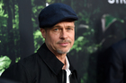 Brad Pitt has compared his split from Angelina Jolie to