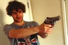 Damon Smith holding a ball-bearing gun. Photo / AP