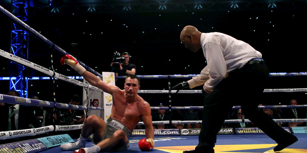 Ukrainian boxer Wladimir Klitschko is knocked down by British boxer Anthony Joshua, during their fight for Joshua's IBF and the vacant WBA Super World and IBO heavyweight titles. Photo / AP.