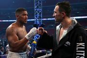 British boxer Anthony Joshua, left, greets Ukrainian boxer Wladimir Klitschko after winning their fight for Joshua's IBF and the vacant WBA Super World and IBO heavyweight titles. Photo / AP.