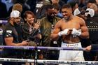 British boxer Anthony Joshua, right, smiles as he celebrates after beating Ukrainian boxer Wladimir Klitschko. Photo / AP