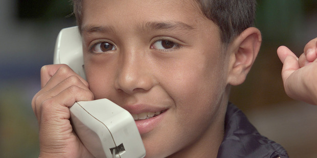Josh Foreman, aged 10, using his cochlear implant to talk by phone to another boy born deaf in Australia. File/Photo