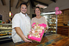 Carol Eivers and Bjorn Schuffelen from Village Green Cafe, Havelock North, where some of the proceeds from their pink macarons will go to the Breast Cancer Foundation during May. Photo/Paul Taylor