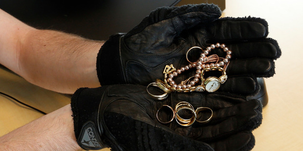 Whangarei police Constable Andrew hunter wants help finding owners for this stolen jewellery. Photo / John Stone