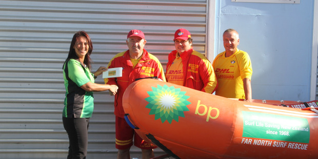 Shelley Matthews presents a brand new IRB to Far North Surf Rescue's Dave Ross, Anthony Walker and Tony Walker.