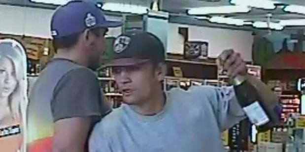 Can you help police identify this man swerving past his mate with two bottles of wine in hand?