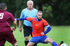 Tikipunga's Carl Challenor makes a play at the ball as referee Warren Bunn watches on. Photo/Tania Whyte