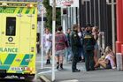 Ambulance officers talk to students after the Stafford St party. Photo / Otago Daily Times