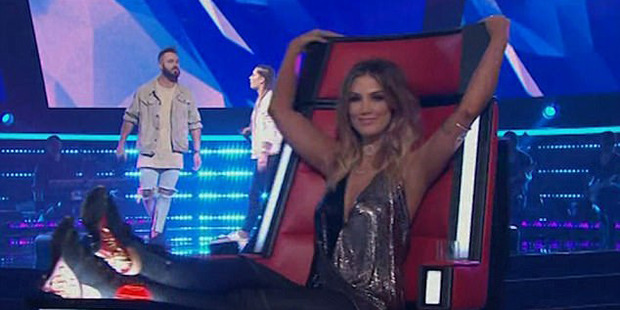 Delta Goodrem uses her feet to turn her chair on The Voice. Photo / Nine