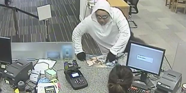 Loading Police are looking for this man in relation to a bank robbery in Glenfield.