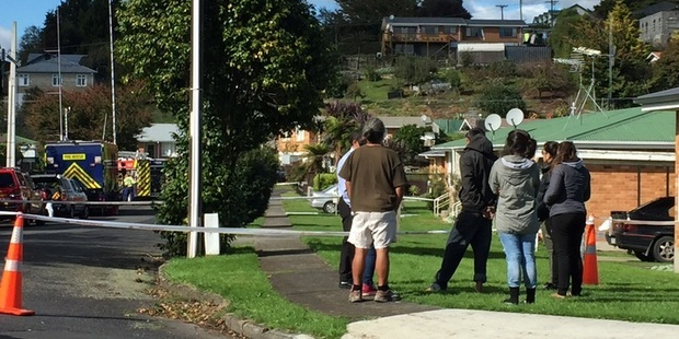 Neighbours gather on Little St in Tirau, where a fatal fire occurred earlier today. Photo/Belinda Feek