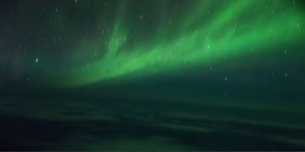 The Southern Lights, or Aurora Australis, from 66 degrees South, 37,000ft over the Antarctic Circle.
