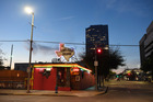 In Houston, day gives way to evening and the neon of the Lone Star Saloon. Photo / Matt McClain