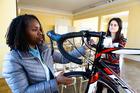 Lekeda Williams, a Backroads job candidate from Waldorf, Maryland, demonstrates her bike-repair skills for Jane Mangione. Photo / Keith Lane