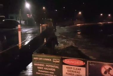 Wild waves lashed the Eastborne coastline overnight leaving logs and debris strewn across the road.  Photo / Chris Andrews