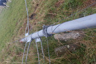 A wind farm data collection tower toppled by vandals near Blueskin Bay, had its equipment broken and guy wires severed. Photo / Otago Daily Times, Supplied