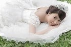 Q May Chen has terminal cancer, but it hasn't stopped her fulfilling her dream of a wedding photo shoot, even if it is on her own