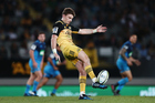 Beauden Barrett of the Hurricanes puts in a kick. Photo / Photosport