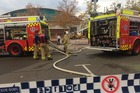 Firefighters attend a building fire at the Sydney Olympic Park precinct. Photo / AAP
