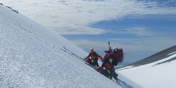 Three tourists were winched to safety after being hit by an avalanche on Mt Taranaki. Photo/Supplied