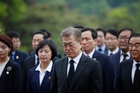 Moon Jae In honours past presidents, independence fighters and war heroes at a national cemetery in Seoul yesterday. Photo / AP
