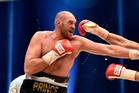 Tyson Fury exchanges blows with Wladimir Klitschko during their 2015 bout. Photo / AP