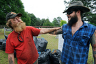 Jimmy Frank Hicks and nephew Tyler Goodson of the hit podcast S-Town, stand at the grave of friend John B McLemore. Photo/AP