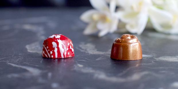 The KFC dark chocolate truffle (left) and milk chocolate truffle. Photo / Supplied
