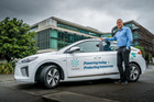 Meridian Energy's general manager of retail Neal Barclay with a Hyundai IONIQ. Photo /Supplied