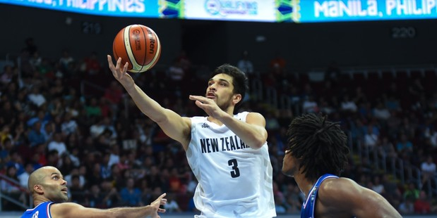 Shea Ili drives to the hoop against France during their Olympic Qualifying match. Photo / Getty Images