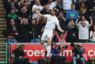 Fernando Llorente celebrates after scoring or Swansea against Everton at Liberty Stadium, Swansea this morning (NZT). Photo / Getty Images.