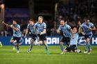 Sydney FC players celebrate after Milos Ninkovic of Sydney scores the winning penalty. Photo / Getty